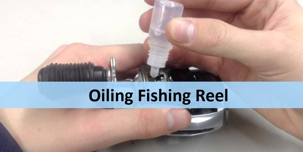 hands oiling a fishing reel